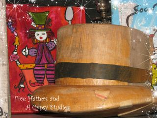 Antique hat form and mad hatter painting