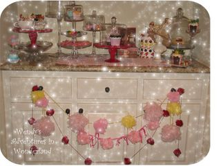 Pink and yellow pom poms with paper pom poms and party area 2