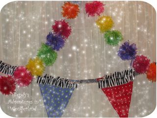 Multi pom pom with bunting close up 2
