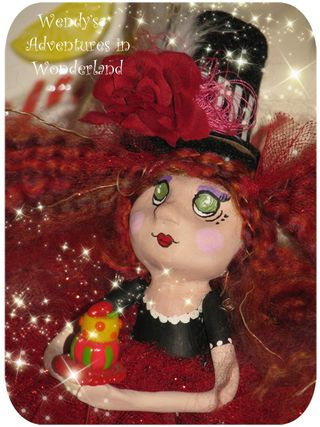 W of w doll whimsical close up with cake pic 1